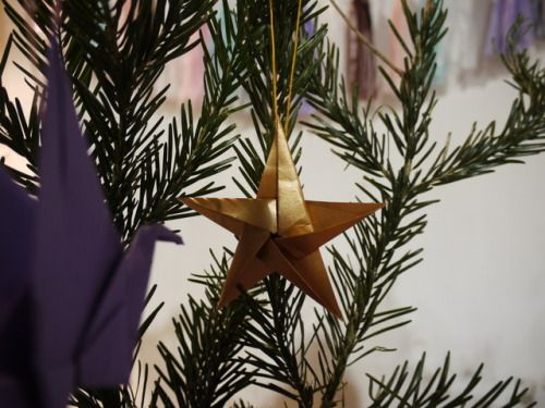 Glittering in the darkness - one of our new origami star decorations! We'll have star, crane and heart tree decorations available alongside a whole host of other decorations