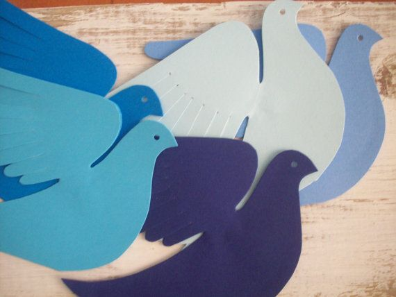 Five sweet cardstock paper birds in shades of blue to attach to a wall or hang as a mobile. Great feather-cut wings, face profile with punched eye and forked tail.  Each bird is cut from doubled cardstock so the wings spread outward in flight. Bend the wings the way you like. Each bird measures about 5.5 x 4 inches. The blues range from dark navy to baby blue. To hang use lightweight string, narrow ribbon or fishing line that you can attach to a hanging loop between the wings.  ($1.50 each)