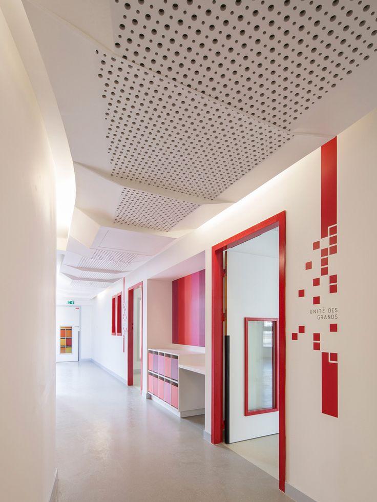 rh + architecture accents parisian childcare center in red