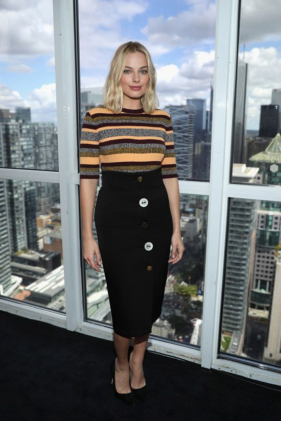Margot Robbie in Apiece apart striped Sweater, Ji Oh 'Front Button skirt' in Black and Jimmy Choo shoes attends The IMDb Studio Hosted By The Visa Infinite Lounge during the 2017 Toronto International Film Festival