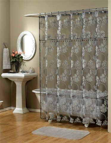 Graphically drawn large scale flowers & leaves adorn this stunning sheer fabric shower curtain. Elegant beaded trim creates a faux valance appearance. 100% Polyester, machine washable. Available in Black, French Vanilla, or White.