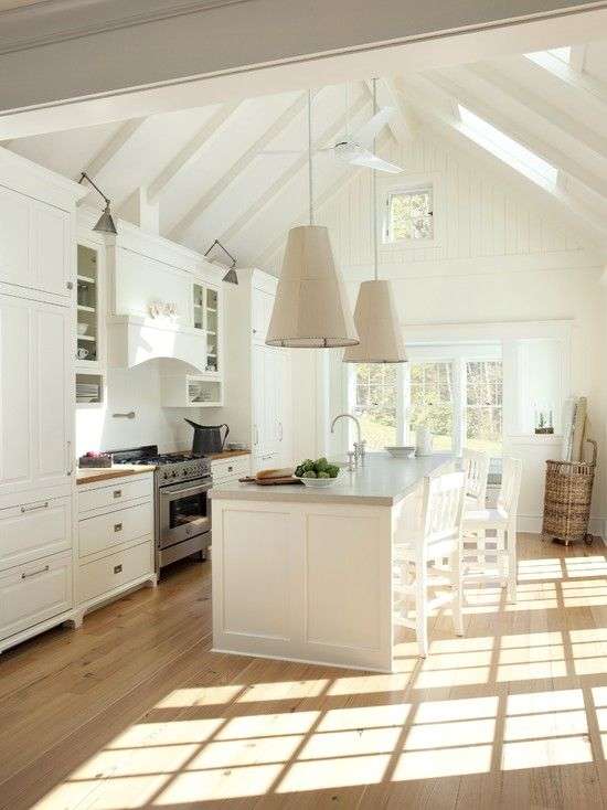 Love the pitched roof  + light & airy feel! Not a fan of the lighting.. but that's an easy change! ;)