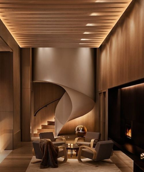 Beautiful modern/contemporary living room with curved stairs, fireplace and lots of wood!