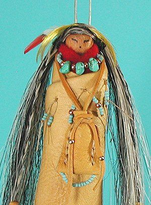 "Apache Shaman Spirit Doll made by Cynthia Whitehawk ""This spirit doll is extremely well made with attention to durability and long life. She will reach out for you and hold you close.  ""Comes with a Certificate of Authenticity, signed by the Artist, Cynthia Whitehawk. She has also signed the wood body of the doll underneath the gown."""