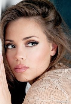 A light sheer lip gloss and settle brown eye shadow for a natural look.