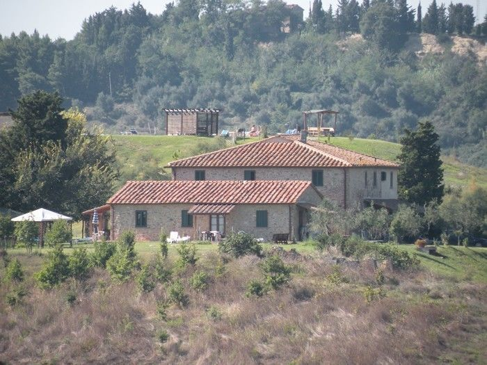 Pelagaccio - Nice farmhouse quietly situated affording beautiful extensive views over the surrounding landscape. The house has been recently restored with its original architectural features preserved and turned into 10 charming apartments, all of which tastefully furnished in a typical Tuscan style. #holiday #property #Italy