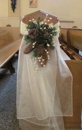 pew swag with ivory organza pine cones pine greens and berry sprigs