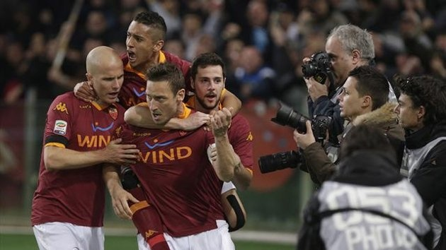 As Roma's Francesco Totti (front) celebrates with teammates after scoring a penalty against Lazio during the derby at the Olympic stadium in Rome April 8, 2013