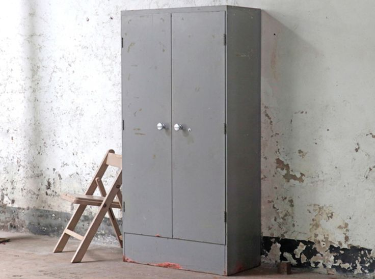 A fine grey vintage industrial storage cabinet - with a slightly distressed surface finish. This piece was once used as a secure Post Office storage cupboard.#cupboard #vintage #homedecor