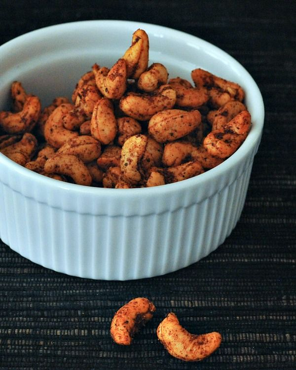 Sweet and Spicy Cashews - a tasty blend of sweet and savory for a warm snack or last minute party food - pop these in the oven all holiday season!