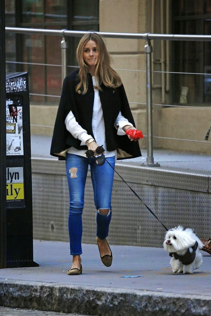 Olivia Palermo in a black cape + white button-up + distressed jeans + smoking slippers