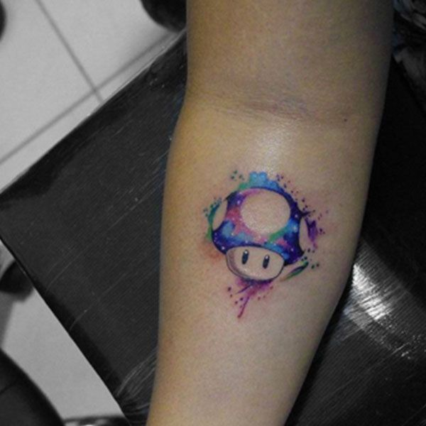 This New Tattoo Trend Is Beautiful #refinery29  http://www.refinery29.uk/2016/04/109346/watercolor-tattoos#slide-9  One way to level up? A colour-splattered mushroom from Mario's world....