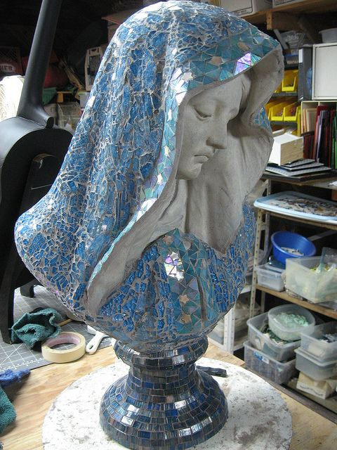 Embellish a Mary statue with mosaic tiles
