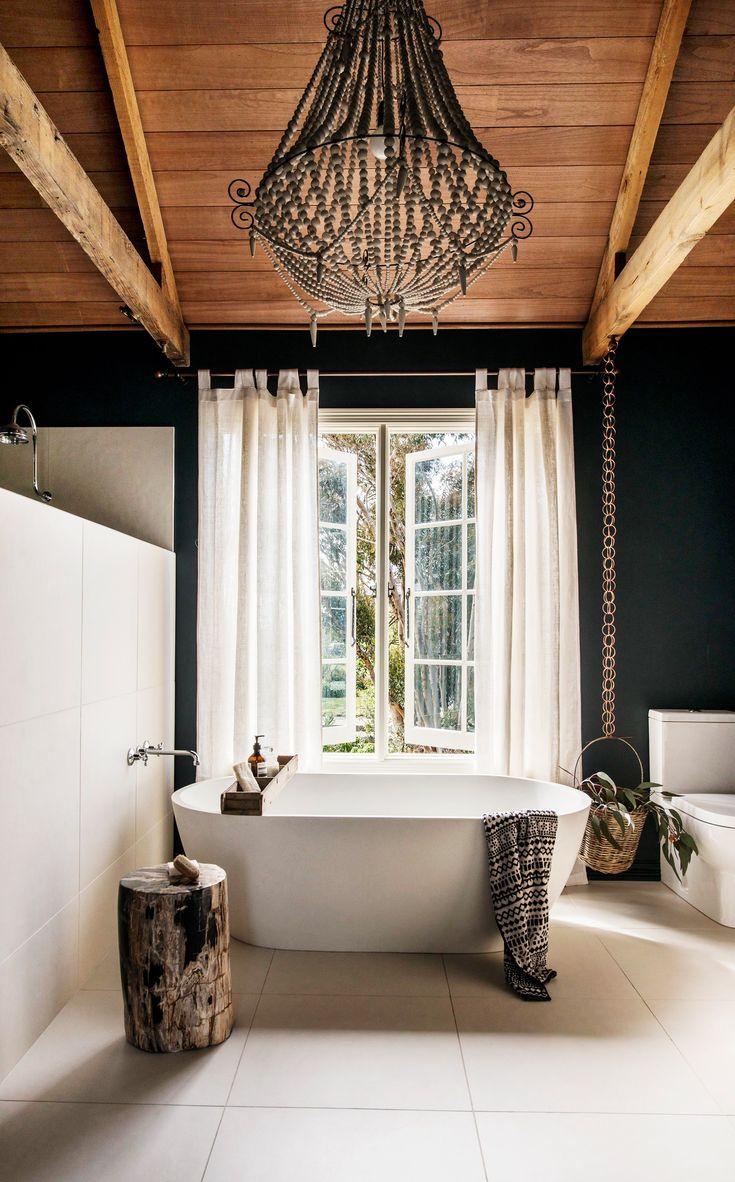 """An airy light balances the weighty timbers in this ensuite bathroom within a [rustic stone cottage](http://www.homestolove.com.au/tim-and-joannes-rustic-stone-cottage-2533