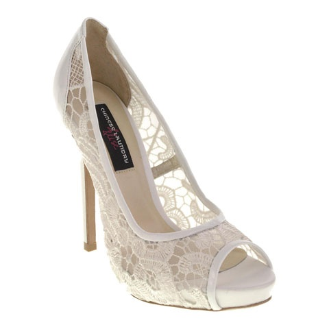 Delicate lace is crafted into a sophisticated pump. The white Tiddlywinks is perfect for your wedding!