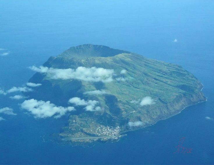 Hiking in Corvo Island, Azores   Small and remote, Corvo Island is the tip of an enormous marine volcano known as Monte Gordo. Its main attraction is Lagoa do Caldeirão, on the bottom of the crater where you can observe nine islets, one for each of the Azores Islands... by Joana AFAR.com