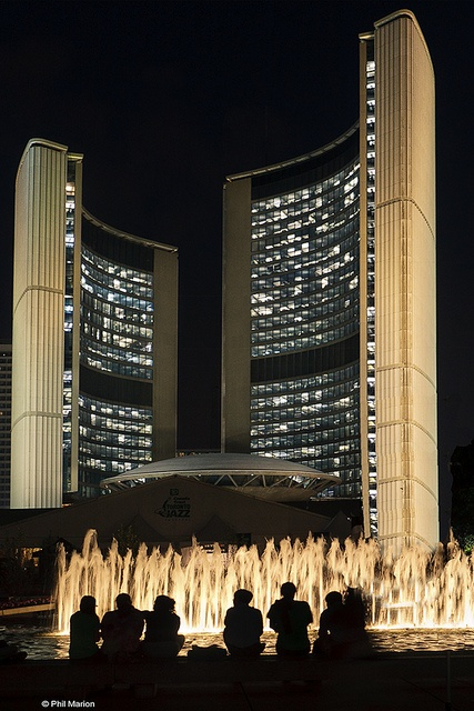 City Hall fountain silhouettes visitors - Toronto by Phil Marion, via Flickr.