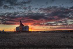 The sunset behind a grain elevator at Kindersley Saskatchewan