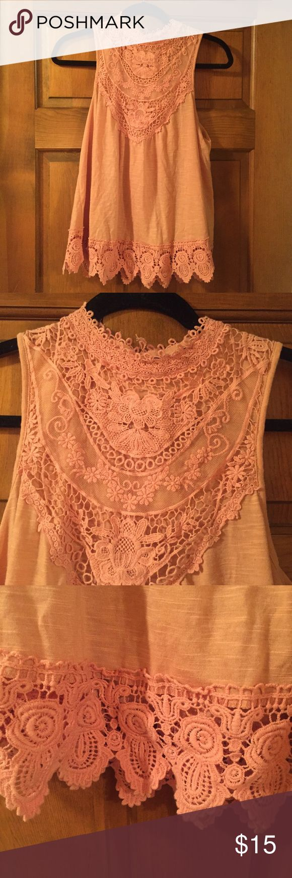 Pink Lace Tank Top Light Pink lace tank top. Razor back cut with button on back top. Lace detailing on top and bottom. Tops Tank Tops
