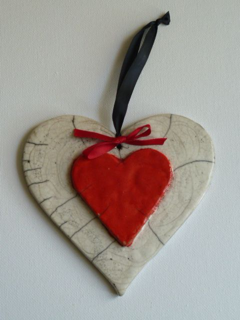 Double heart in white and red Raku glaze - red bow with deep navy ribbon