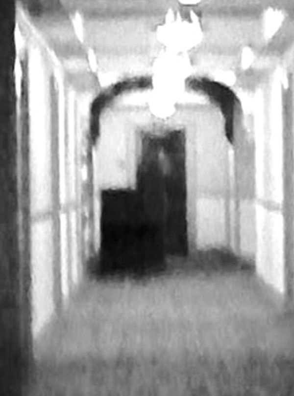 This photograph was taken on the 01/04/2014 at Stanley Hotel Estes Park CO USA. Female apparition leaning against the desk.