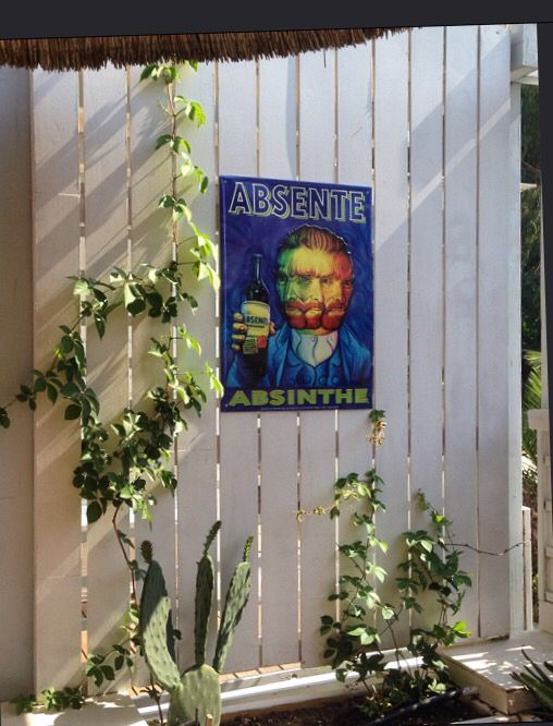 Van Gogh in an Absinthe sign at Lotus bar, Ios, Greece