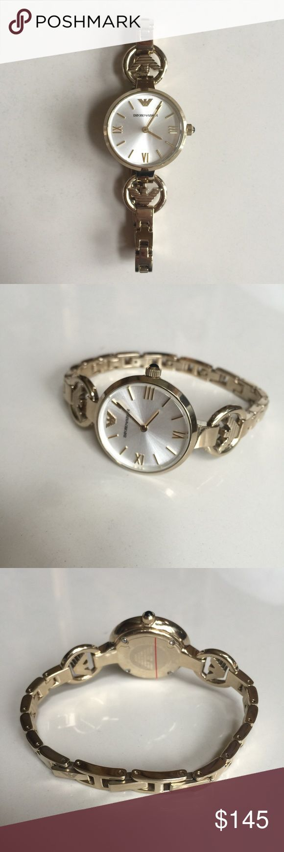 Emporio Armani Retro Ladies Watch AR1774 100% authentic Emporio Armani Retro Ladies Watch AR1774. Roman numeral hour markers. Quartz movement. In excellent condition. Emporio Armani Accessories Watches