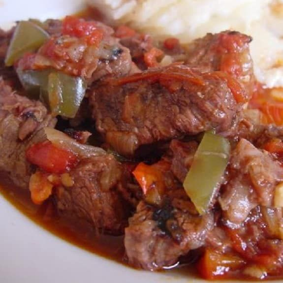 Pressure cooker Swiss steak casserole recipe.Beef round steak with vegetables,tomato paste and dry red wine cooked in electric pressure cooker. Fast and extremely delicious beef recipe.