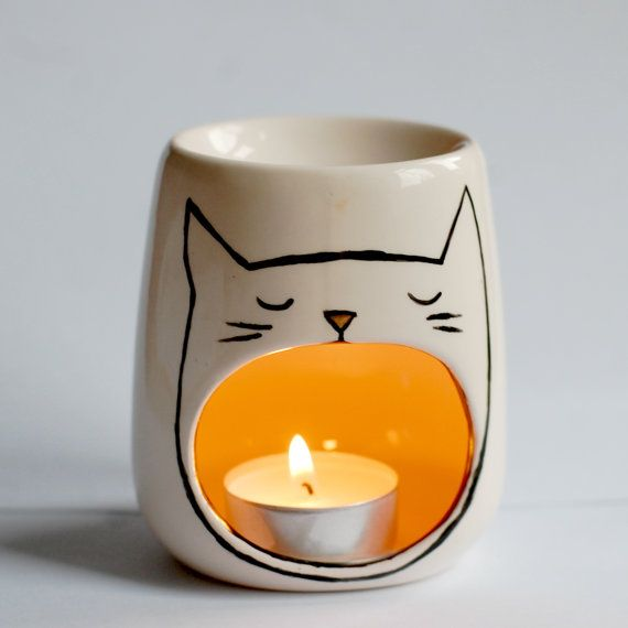 A sweet little yawning cat oil burner, hand painted in black enamel with a uniquely designed illustration of a sleepy, yawning cat!  Perfect for