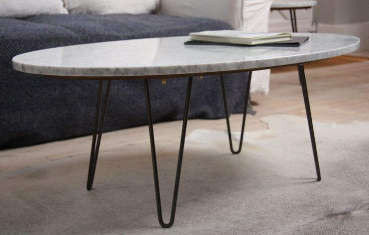 Our beautiful Betsy coffee table was the original MOffee design. Named after our daughter, it's a favorite of ours! The Carrara Marble top and hairpin legs are perfectly married by the handcrafted base-plate, linking the classic to the contemporary.
