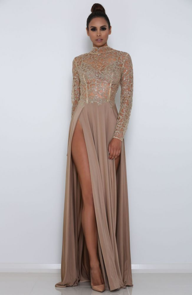 Long sleeve high neck sequin sheer long evening luxe gown with double slit in front Details - Polyester - Sequin, Jersey - Imported - Delicate Cold Wash - Fits True To Size