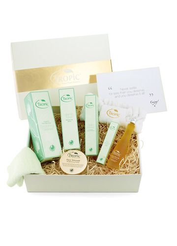 Receive all the power of our A.B.C skin care range and more with this Deluxe Skin Care Gift Box Collection! Encased in wood wool, Tropic tissue paper and presented in a luxurious cream and gold gift box!  1. Smoothing Cleanser 2. Vitamin Toner 3. Skin Revive Nourishing Cream 4. Face Smooth 5. Eye Refresh 6. Organic Elixir Oil 7. Tropic Headband Learn more at https://www.tropicskincare.co.uk/shop/gina/products.html