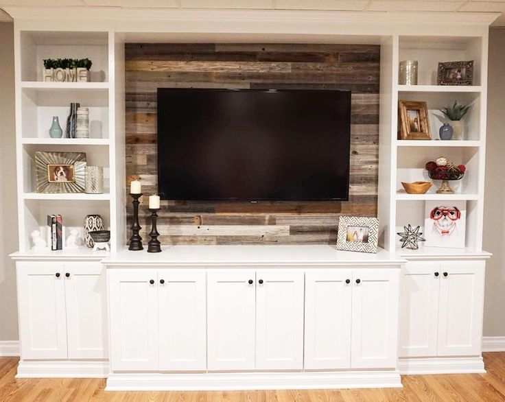 #InspirationSaturday Just a touch of reclaimed barn wood really pops against this white entertainment center. Without it the area would lose interest but with the wood planks this living room gains character and warmth.