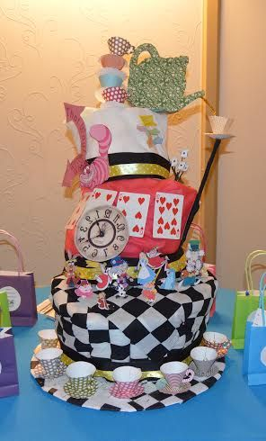 Topsy Turvy Diaper Cake Idea! My Mother-in-law did such a wonderful job making this Mad Hatter Tea Party Themed Diaper Cake! Lots of effort into the detail, it accented all of the other decorations perfectly!