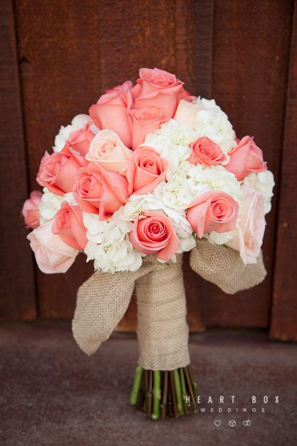 Beautiful bride's bouquet with coral and white roses tied together with burlap ribbon #ceremony #bride #floral #bouquet #roses #coral #burlap