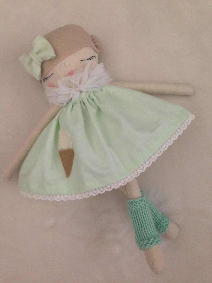 Handmade darling doll, wearing a mint dress with ice cream.