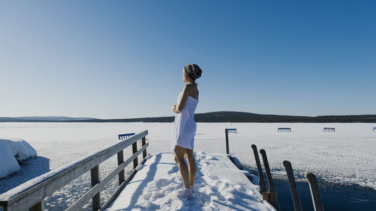 Ice cold swim with fire hot sauna - Finland