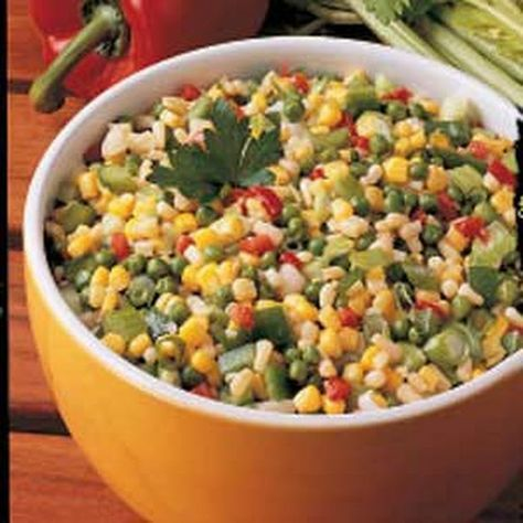 Crunchy Corn Medley Recipe Side Dishes with frozen peas, whole kernel corn, drain, shoepeg corn, water chestnuts, drained and chopped, diced pimentos, green onions, celery ribs, green pepper, white vinegar, sugar, vegetable oil, salt, pepper