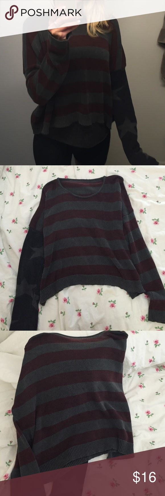Brandy Melville sweater Authentic brandy Melville sweater with American flag design of Stars and Stripes. In good used condition. One small spot on the backside, hardly noticeable when wearing and may come out in the wash-not sure. Fits like a small. Brandy Melville Sweaters