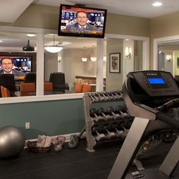 Windows in basement exercise room - great way to look into play room.