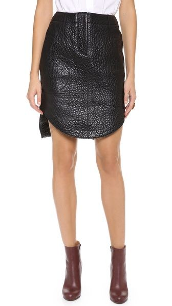 Double, triple, quadruple yes all over this skirt. Pebbled leather, a demure length with sexy side curves and  mild homage to that Alexander Wang bag you still have. This Carven is wear to work or dinner date ready.   Carven Leather Skirt