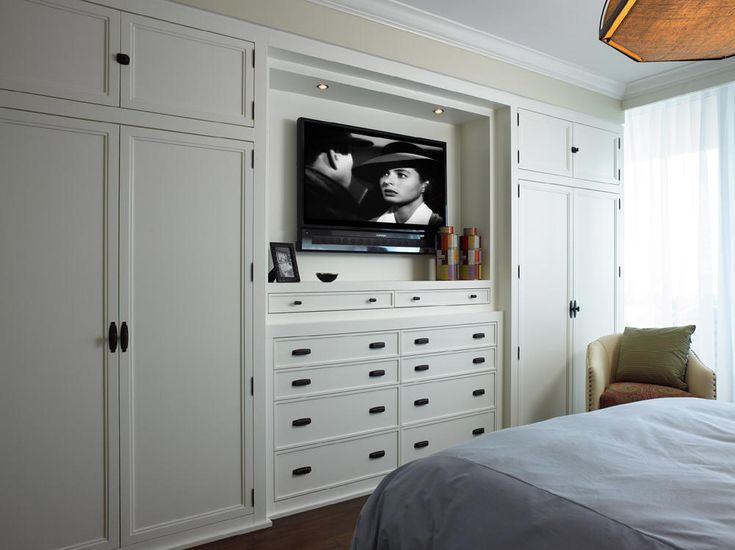 Built-In closet + Drawers + TV.  Space Planning for when the current bay window becomes a doorway to the outside pool and the sectional is rotated due to the change of traffic pattern through the space.  A piece of Art or Mirror could do where the TV is positioned, temporally.