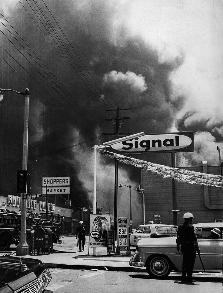 Aug. 14, 1965.  Smoke from a row of buildings burning on Central Ave, , south  of 43rd St., darkens sky during the Watts Riot.