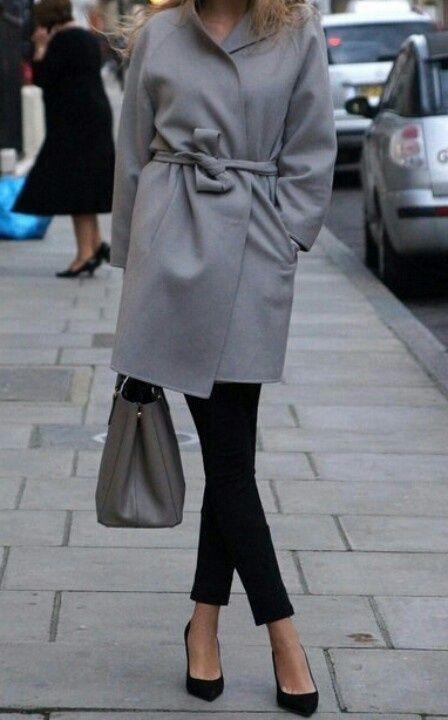 Go for a sophisticated look in a grey coat and black slim pants. Finish off your look with black suede pumps.   Shop this look on Lookastic: https://lookastic.com/women/looks/grey-coat-black-skinny-pants-black-pumps/16529   — Grey Coat  — Grey Leather Tote Bag  — Black Skinny Pants  — Black Suede Pumps