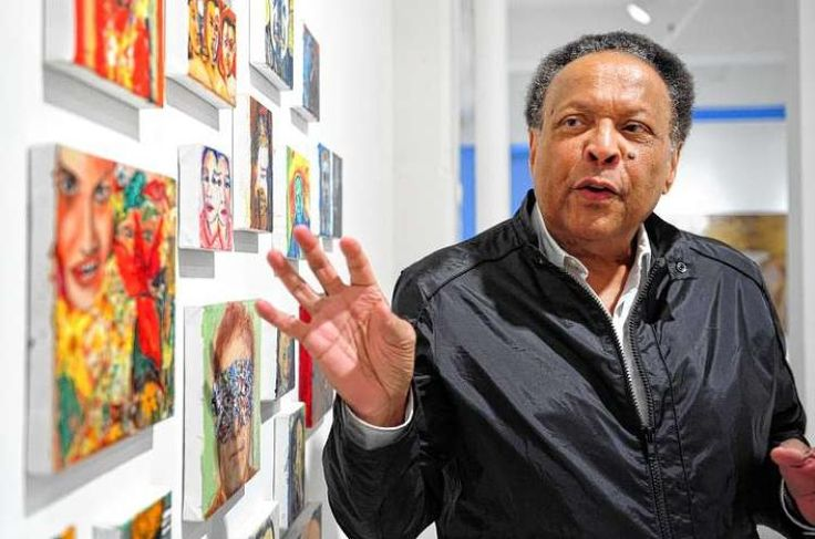 """John Johnson with works in his exhibit, """"The Human Circus,""""at Walter Wickiser Gallery"""