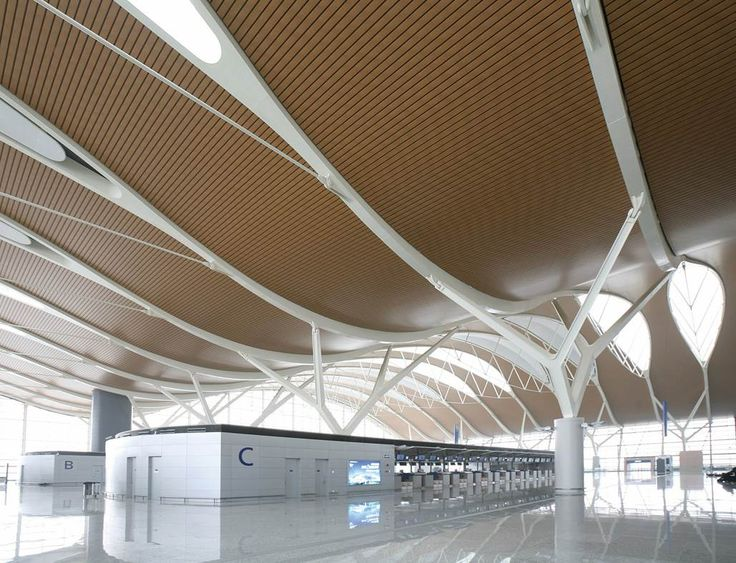Project: Pudong International Airport. T2Location: Shanghai, China.Architect: East China Architectural Design                   & Research Institute. Product: Hunter Douglas Ceilings - Aluminium Wood Print Linear 180B.  #hunter douglas #airport #architecture