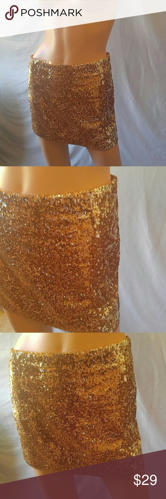🌟Gold Sequin Skirt! WOW!!! CLOSET CLEAROUT SALE: $6 or 4 for $20 (anything $6 or less) $9 or 3 for $25 (anything $9 or less)  What a fabulous look to go anywhere. Gold mini for special events or just to feel fantastic. Side zip    Why buy from me? 💋Most Items New with tags or worn once 💋Smoke free home  💋TOP 10% Seller  💋TOP RATED 💋 FAST SHIPPER   💋ACCEPT MOST OFFERS 💋BUNDLE DISCOUNT OF 20% 💋Allow EXCHANGES 💋Speedy response for questions  ❤Let me know how I can help & HAPPY…
