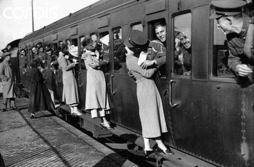 Kiss kisses goodbye solider soliders war men women girl boy black and white photography photo vintage world war away train railroad tracks