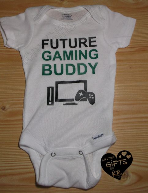 Future Gaming Buddy Custom Onesie.  Great gift for that new dad, or that special gamer you know that is or has a child :).  Let me know if there is a different design you are looking for and I will be happy to do that for you :)  Great Baby Shower Gift ;)  100 % cotton  I heat press my ...