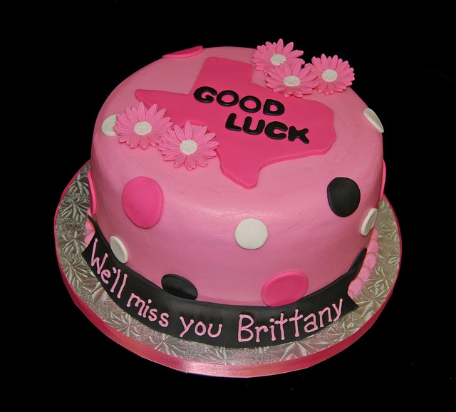 Pink and Black Going Away Cake with polka dots and daisies